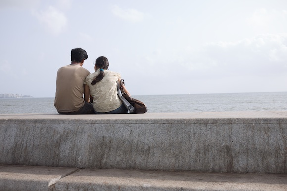 A couple sitting together on Marine Drive in Mumbai, India