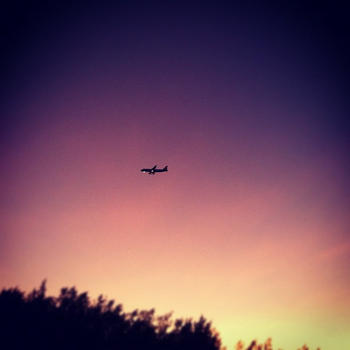 [Photo] Airplane at sunset, landing in Cairns International Airport, as seen from Yorkey's Knob Beach, QLD, Australia.